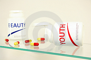 Youth And Beauty Pills In A Bottle Stock Photography - Image: 14944982