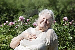 Senior Woman Enjoying The Summer Garden Royalty Free Stock Photo - Image: 14947695