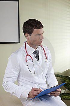Male Doctor With Paperwork Stock Image - Image: 14950271