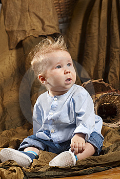 Baby Sitting On A  Floor Stock Image - Image: 14959081