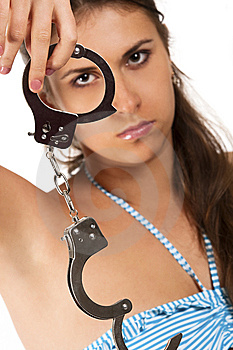 Brunet Looking Through Handcuffs Stock Image - Image: 14959111