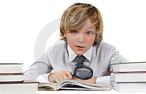 Schoolboy With Books And Magnifying Glass Stock Photo - Image: 14974470