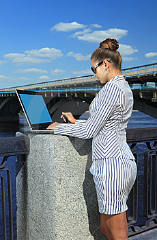 Woman With Laptop On Quay Stock Images - Image: 14978974