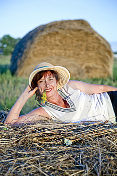 Portrait Of Woman Lying On A Haystack Stock Photos - Image: 14982963