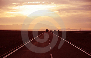 Sunset Alsphalt Highway Royalty Free Stock Image - Image: 14986256