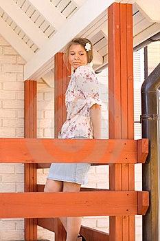 Girl On A Veranda Royalty Free Stock Image - Image: 14989716