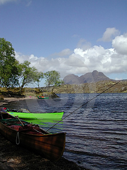 Canoes And Mountain Free Stock Photo