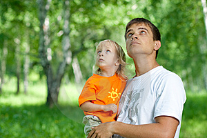 Father And Son In His Hands Watching Up Outdoors Royalty Free Stock Images - Image: 15001299