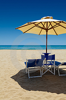Deck Chairs Under An Umbrella Royalty Free Stock Photography - Image: 15003847