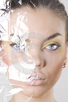 Female Face Wrapped In Cellophane Stock Images - Image: 15007494