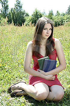 Teen Girl Sitting On The Grass Stock Images - Image: 15018194