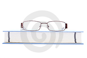 Eyeglasses On The Blue Book Royalty Free Stock Photography - Image: 15019457