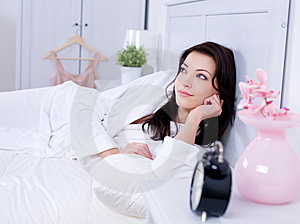 Beautiful Woman Lying On A Bed Stock Images - Image: 15020574