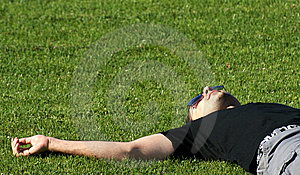 Young Man Relaxing On Field Royalty Free Stock Photo - Image: 15023895