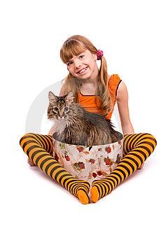 Little Girl Wearing Orange Dress Is Sitting Stock Photos - Image: 15025493