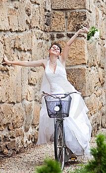 Happy Bride Riding A Bike Royalty Free Stock Photos - Image: 15054098