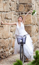 Happy bride riding a bike Royalty Free Stock Photos