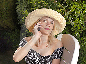 Confident Blond Woman On Mobile Phone Royalty Free Stock Photo - Image: 15064325