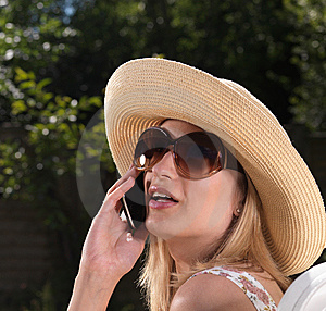 Confident Blond Woman On Mobile Phone Stock Photography - Image: 15064372