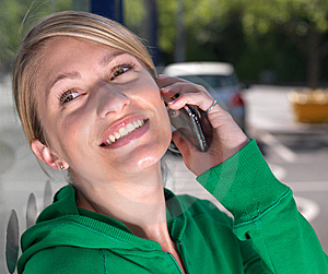 Smiling,confident Blond Woman On Mobile Phone Royalty Free Stock Image - Image: 15064436
