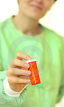 Doctor Holding Bottle Of Prescription Pills Stock Photos - Image: 15071703