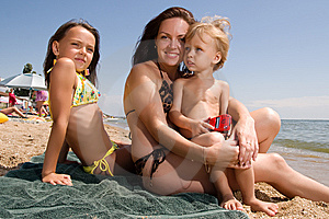Young mother with kids at the summer resort