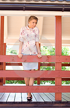 Girl On A Veranda Stock Images - Image: 15074424