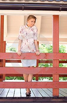 Girl On A Veranda Stock Images - Image: 15074424