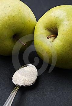 Teaspoon Sugar Vs Green Apples Royalty Free Stock Photos - Image: 15074688