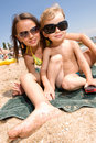 Two young kids having fun at the beach Stock Image
