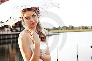 Young Woman Holding A Parasol By The Water Royalty Free Stock Photo - Image: 15082705