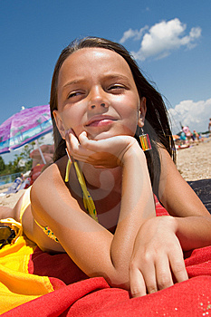 Little Girl Sunbathing At The Beach Stock Image - Image: 15082851
