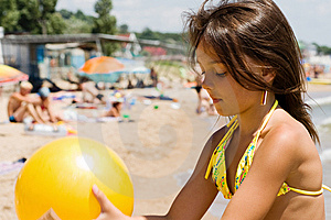 Little Girl Plays Ball At Crowded Seaside Royalty Free Stock Image - Image: 15082886