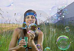 Woman Blows Soap Bubbles Royalty Free Stock Photo - Image: 15083745