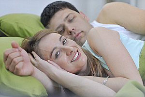 Young Couple In Bed Stock Photo - Image: 15097470