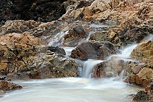Small Waterfall At Beach Royalty Free Stock Image - Image: 15098316