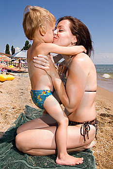 Young Mother Kissing Her Son At The Beach Stock Photos - Image: 15105823