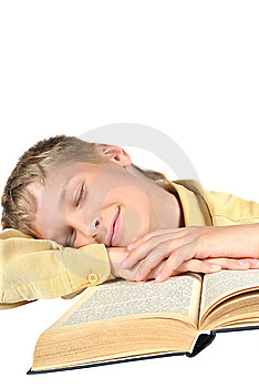 The Teenager Fell Asleep Reading A Book Stock Image - Image: 15111401