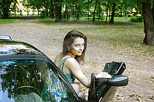 The Beautiful Girl Is Sitting In The Car Royalty Free Stock Photo - Image: 15113425
