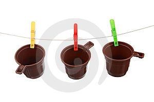 Plastic Glasses Hang On Clothespins Royalty Free Stock Photos - Image: 15147218
