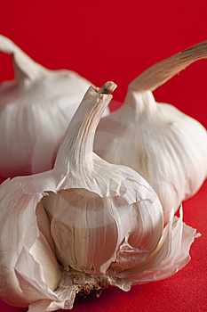 Garlic On Red Background, Half Clove Royalty Free Stock Images - Image: 15150189
