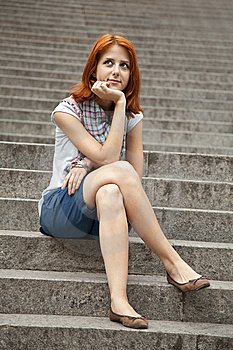 Portrait Of Beautiful Red-haired Girl On Footstep. Stock Photos - Image: 15154553