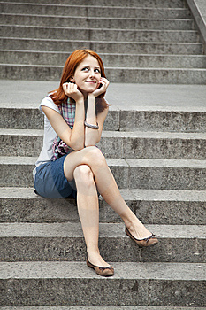 Portrait Of Beautiful Red-haired Girl On Footstep. Stock Photography - Image: 15154572