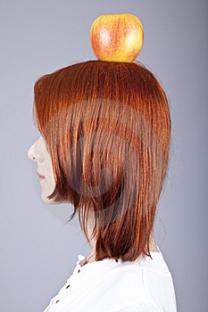 Red-haired Girl Keep Apple On Her Head. Royalty Free Stock Images - Image: 15155209