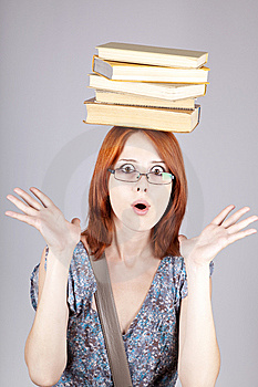 Red-haired Girl Keep Books On Her Head. Royalty Free Stock Photography - Image: 15155277