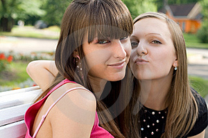 Two Female Friends  On Bench Royalty Free Stock Images - Image: 15155819