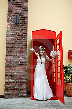 Bride In The Telephone Cabin Royalty Free Stock Image - Image: 15156276