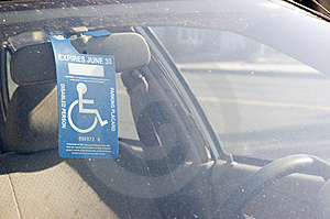 Handicap Sign On A Rear View Mirror Royalty Free Stock Photo - Image: 15163045