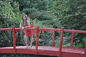 She Stands Upon The Red Bridge Royalty Free Stock Photo - Image: 15164335