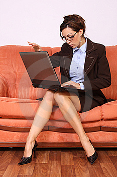 Woman Sitting On The Sofa Working On Lap Top Royalty Free Stock Photography - Image: 15167817